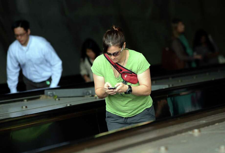 3. Walking very, very slowly while you look at your phone. Photo: JEWEL SAMAD, Getty Images / 2012 AFP