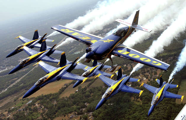 The United States Navy Blue Angels and world-renowned aerobatic pilot Michael Goulian form up for a flight over Dayton Municipal Airport in Vandalia, Ohio on Thursday, July 5, 2012. Photo: AP