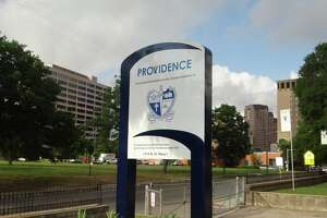 """Providence Catholic School in downtown San Antonio has an updated outdoor sign. With fresh paint and bold colors, the Providence crest, a symbol of the school's heritage, takes center stage. """"The symbols of the Crest, Mary holding the child, the urn of wisdom, the scriptures, the cross of Providence, and the eye of God's Providence ever-present, reflect the values of a Providence education,"""" explained Principal Alicia Garcia in a news release. Commissioning the new sign was a project of the Providence Parents' Club (PPC)."""