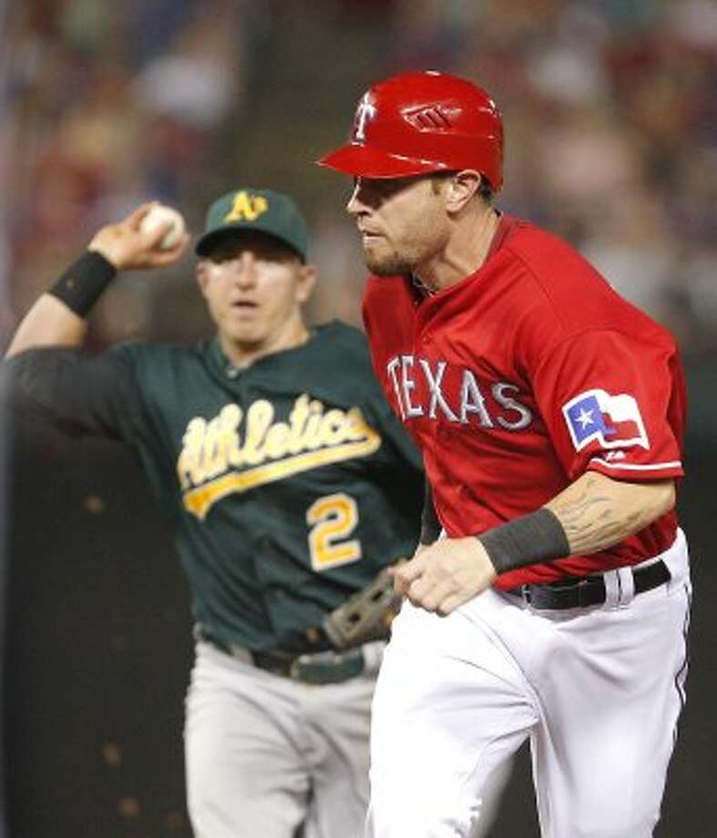 Texas Rangers Josh Hamilton is caught in a rundown as Oakland Athletics shortstop Cliff Pennington (2) closes in during the sixth inning of a baseball game Thursday, June 28, 2012, in Arlington, Texas.  The Rangers won the game 7-6.  (AP Photo/Tim Sharp) (ASSOCIATED PRESS)