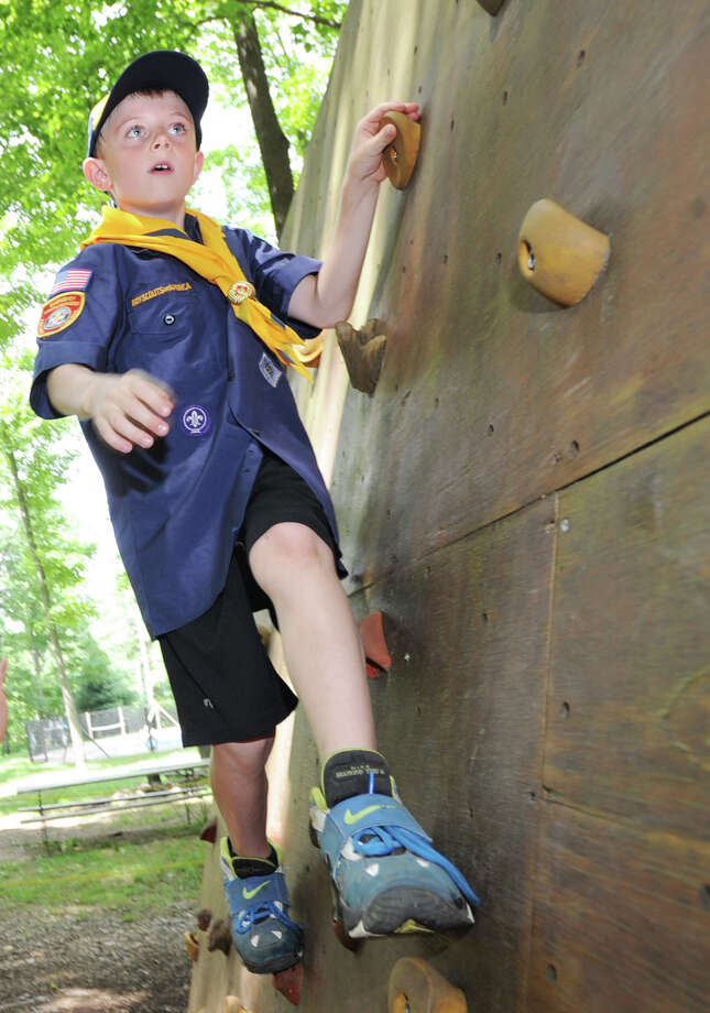 Greenwich Cub Scout Carter Simko, 8, navigates a climbing wall at the Ernest Thompson Seton Reservation in Greenwich, Thursday, July 5, 2012. The Greenwich Council of the Boy Scouts of America is located at the reservation and is celebrating its 100th anniversary July 12. Photo: Bob Luckey / Greenwich Time