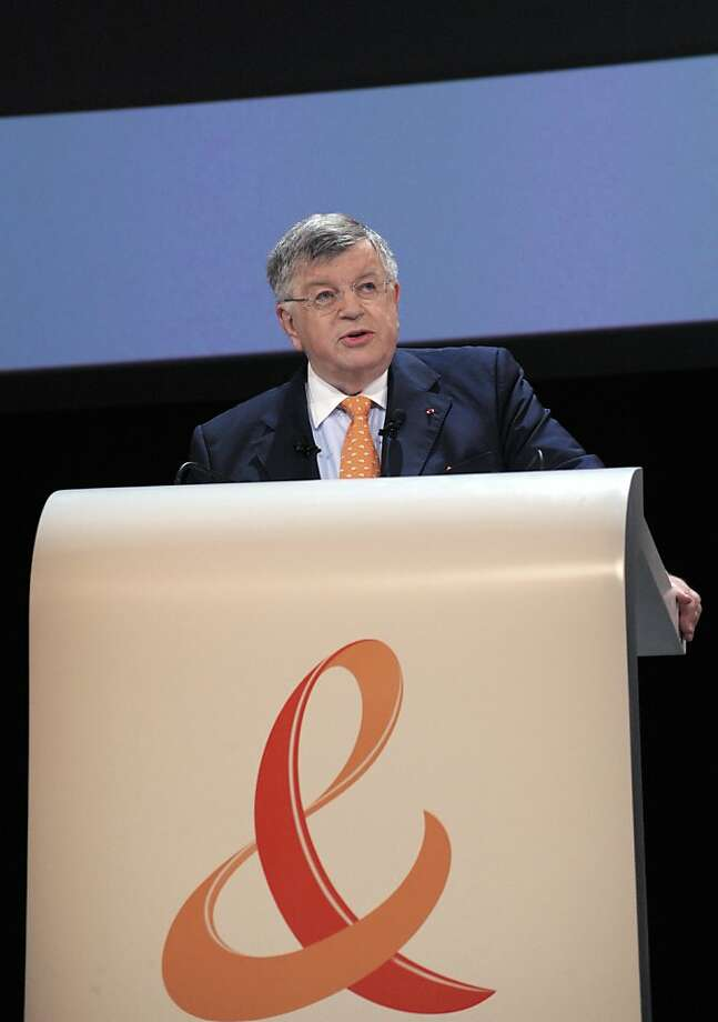 (FILES) - A picture taken on June 9, 2010 in Paris, shows France Telecom's President Didier Lombard (L) delivering a speech during a general meeting. More former executives of France Telecom are to go before an investigating magistrate on July 5, 2012, a day after the ex-head of the company was placed under investigation over a spate of suicides there. Lombard, who ran the company between 2005 and 2010, was told on July 4, 2012 he was being investigated for workplace harassment and put on bail of 100,000 euros ($125,000), his lawyer Jean Veil said.  AFP PHOTO ERIC PIERMONTERIC PIERMONT/AFP/GettyImages Photo: Eric Piermont, AFP/Getty Images
