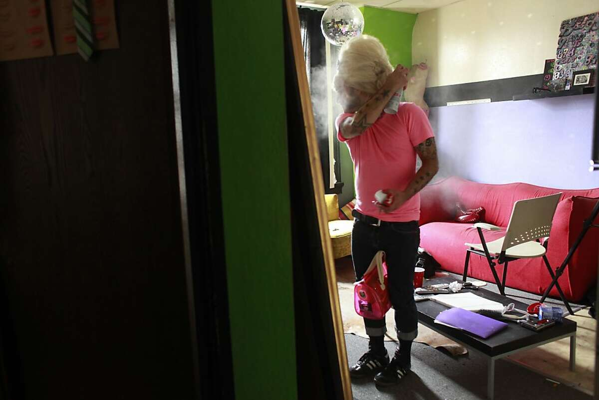 With the help of a can of hairspray, Anthony Torres transforms into Bubbles in his apartment in San Francisco, Calif.