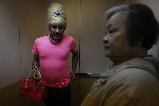 Bubbles rides the elevator with a neighbor in his apartment building in San Francisco, Calif. Photo: Mike Kepka, The Chronicle