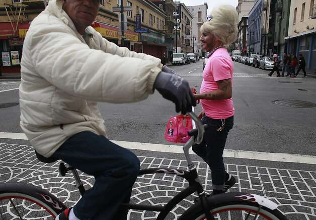 Bubbles heads through the Tenderloin in San Francisco, Calif. Photo: Mike Kepka, The Chronicle