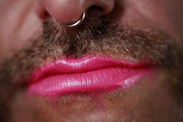 Dressed as Bubbles, Anthony Torres shows off pink lipstick in San Francisco, Calif. Photo: Mike Kepka, The Chronicle