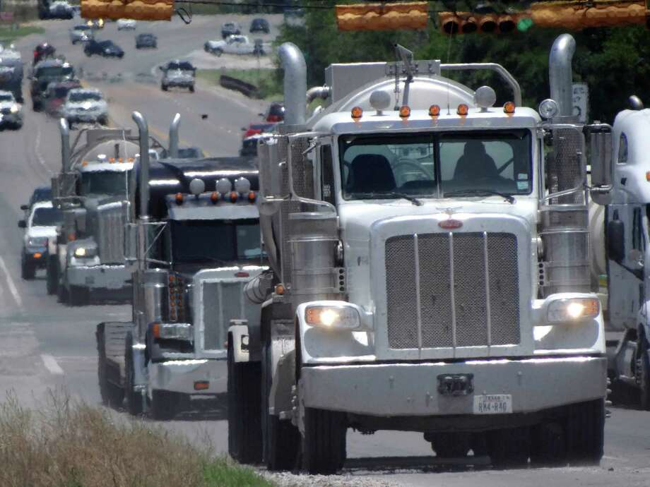 Trucks related to the Eagle Ford Shale energy industry make their way along Highway 181 in Kenedy, Texas, on Friday, July 6, 2012. Photo: Billy Calzada, San Antonio Express-News / © 2012 San Antonio Express-News