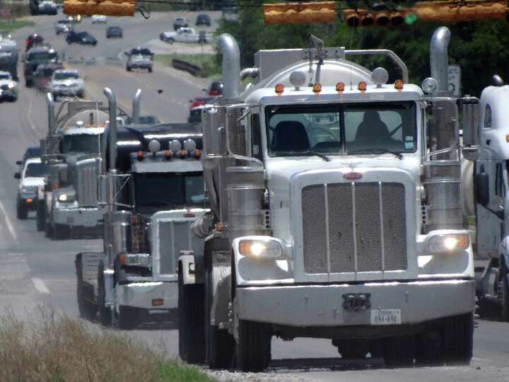 Trucks related to the Eagle Ford Shale energy industry make their way along Highway 181 in Kenedy, T