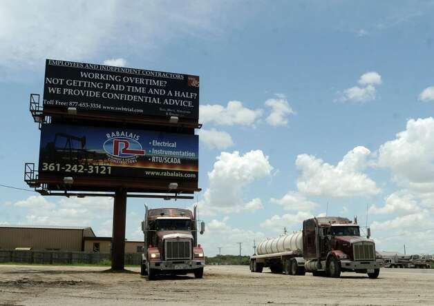 Trucks are a common sight in Kenedy, Texas, on Friday, July 6, 2012. The Eagle Ford Shale energy industry has created many jobs and truck traffic has increased. Photo: Billy Calzada, San Antonio Express-News / © 2012 San Antonio Express-News