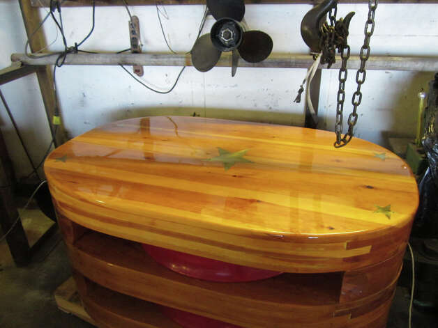 A coffee table, created by Kaye Williams from a block (pulley) from a large ship, will be included in a City Lights Gallery show that opens on Thursday, July 19. Photo: Contributed Photo