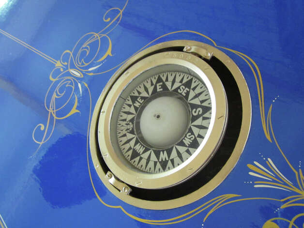 Shown is detail work, with a nautical compass, from a casket that Kaye Williams has built for himself. It will be on view at City Lights Gallery, in Bridgeport, in an exhibit that opens on Thursday, July 19. Photo: Contributed Photo