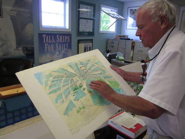 Kaye Williams, who will be honored at a maritime art show at City Lights Gallery, reviews a sketch of one of his ideas to renovate Pleasure Beach. Photo: Contributed Photo