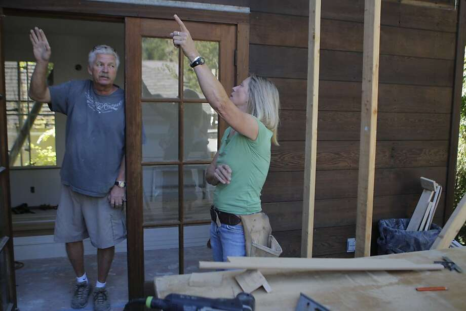 Tina Humphrey, the general contractor who runs a company called Buildergirl Designs and Construction works onsite at a Storybook cottage in Mill Valley, Calif. on Tuesday, June 26, 2012. Tina always posts a before and after photo of her project for the neighbors and people passing by. Photo: Megan Farmer, The Chronicle