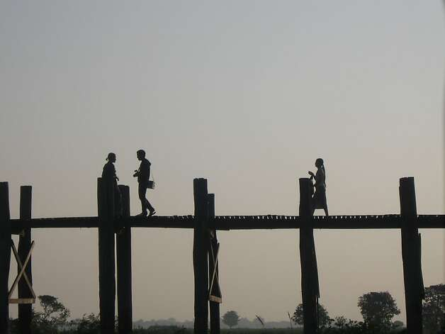 The 1,300-yard-long U Bein's Bridge, located just outside Mandalay, is the longest teak span in the world. Photo: David Farley