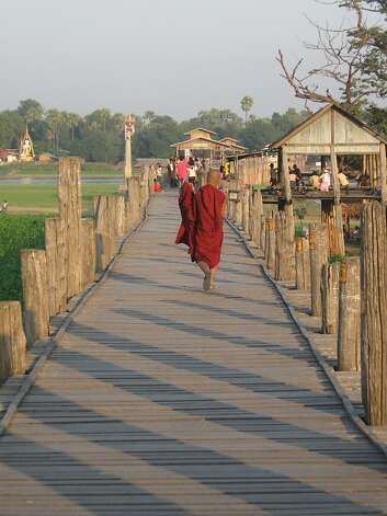 U Bein's Bridge, best visited at sunrise or sunset, is traversed by Buddhist monks -- and the occasional tourist. Photo: David Farley