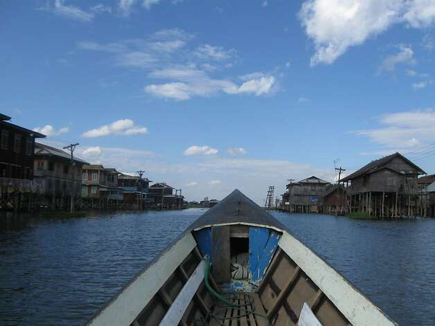 The best -- or only -- way to get from teak-made, stilted villages in Inle Lake is by hiring a boat and driver. Photo: David Farley