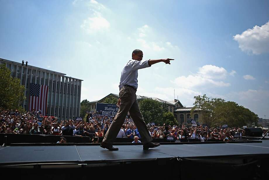 "PITTSBURGH, PA - JULY 06: U.S. President Barack Obama arrives at a campaign event on the College of Fine Arts Lawn at Carnegie Mellon University July 5, 2012 in Pittsburgh, Pennsylvania. The Obama campaign wrapped up its ""Betting On America"" bus tour through Northern Ohio and Western Pennsylvania on Friday. The president continued to highlight his administration's efforts to improve the economy by creating manufacturing jobs and rescuing the American auto industry while taking swings at the presumptive Republican presidential nominee, former Massachusetts Gov. Mitt Romney. (Photo by Chip Somodevilla/Getty Images) Photo: Chip Somodevilla, Getty Images"