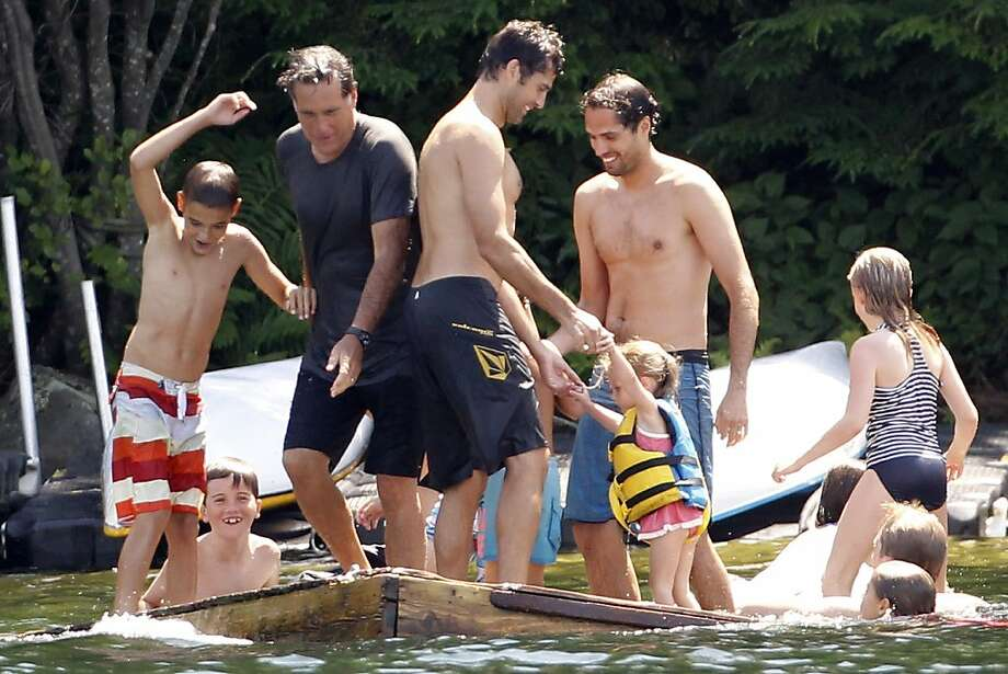 Republican presidential candidate, former Massachusetts Gov. Mitt Romney plays with family and friends on a floating raft on Lake Winnipesaukee in Wolfeboro, N.H., Friday, July 6, 2012, as he continues his vacation from the campaign trail. (AP Photo/Charles Dharapak) Photo: Charles Dharapak, Associated Press
