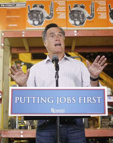 Republican presidential candidate Mitt Romney speaks about job numbers and takes questions from reporters at Bradley's Hardware in Wolfeboro, N.H., Friday, July 6, 2012. (AP Photo/Charles Dharapak) Photo: Charles Dharapak, Associated Press
