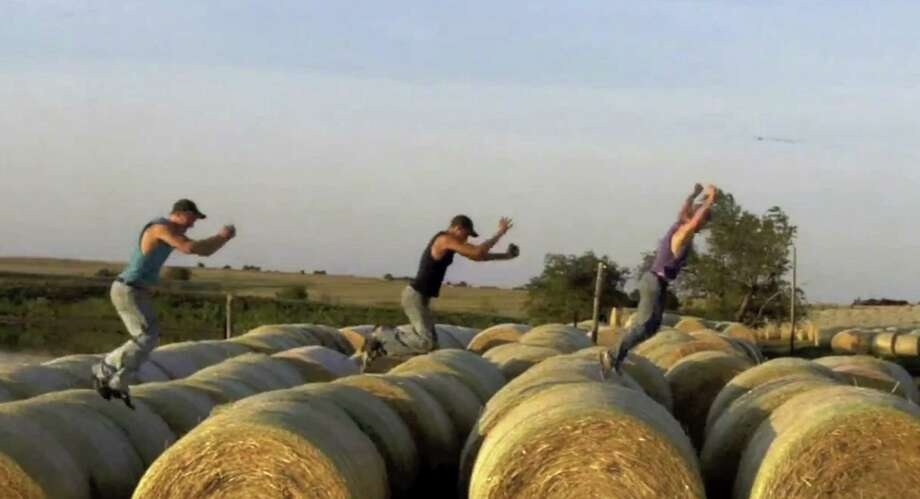 """This frame grab shows brothers, from left: Nathan; Kendal and Greg Peterson in their video parody on LMAFO's """"Sexy and I Know It,"""" in Assaria, Kan. / Courtesy Greg Peterson"""