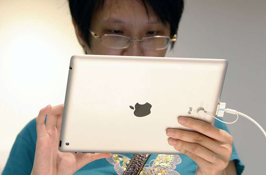 Apple's market share climbed to 69.6 percent in the quarter from 58.1 percent in the previous quarter. Photo: Lai Seng Sin, Associated Press