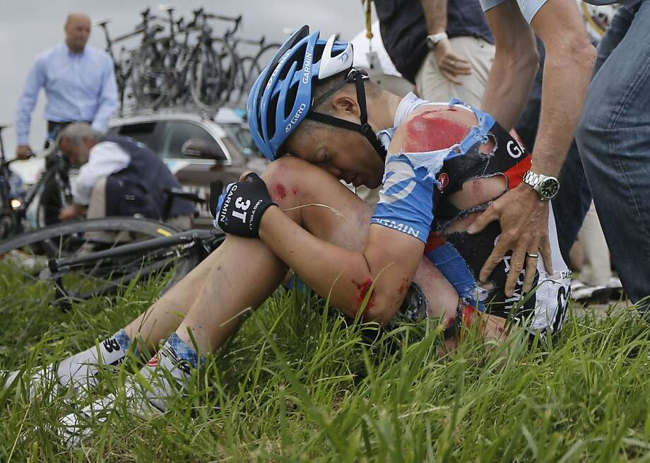 Injured Thomas Danielson of the US sits in the grass after a crash in thew pack at some 20 kilometers from he finish line during the sixth stage of the Tour de France cycling race over 207.5 kilometers (129 miles) with start in Epernay and finish in Metz, France, Friday July 6, 2012. (AP Photo/Laurent Cipriani) Photo: Laurent Cipriani, Associated Press
