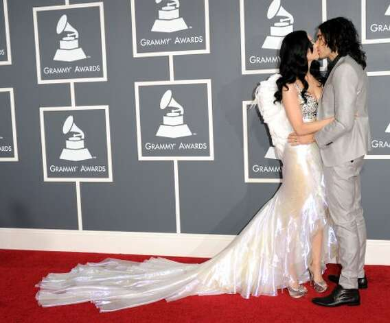 Happier times with then-husband Russell Brand in 2011 at the Grammys in Los Angeles.   (Jason Merritt / Getty Images)