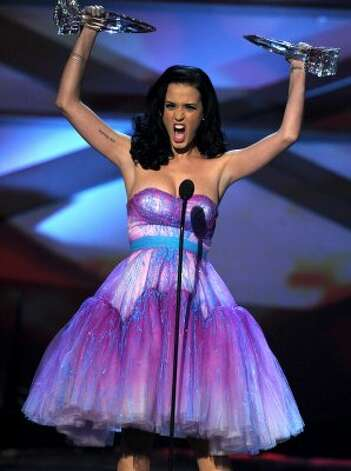 Katy Perry wins the 2011 Favorite Female Artist and Favorite Pop Artist awards at the People's Choice Awards.  (Kevin Winter / Getty Images)