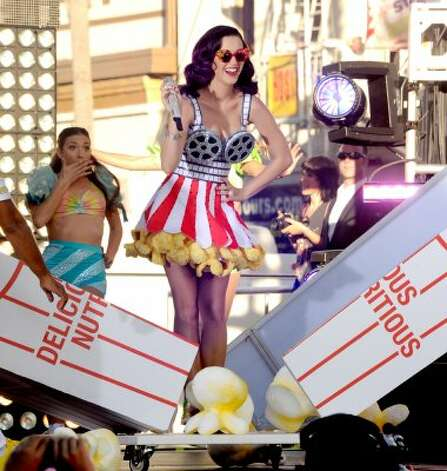 "Katy Perry emerges from a popcorn box during a performance at the premiere of her new movie, ""Katy Perry: Part Of Me,"" in Hollywood on June 26.  (Kevin Winter / Getty Images)"