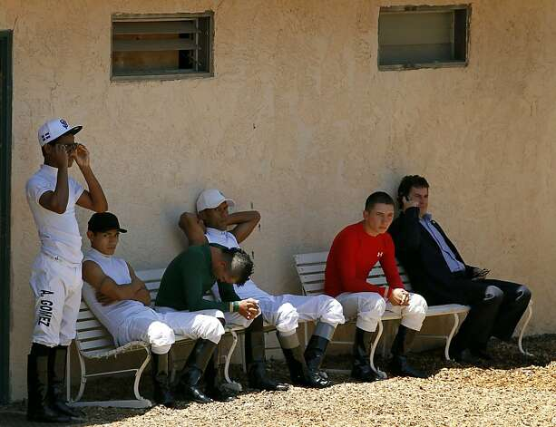 Jockeys gahter outside their clubhouse before a tribute to Jorge Herrera, at the Alameda County Fair in Pleasanton, Calif. on Friday, July 6, 2012, the jockey who died while riding Morito in the eighth race on Thursday. Photo: Paul Chinn, The Chronicle