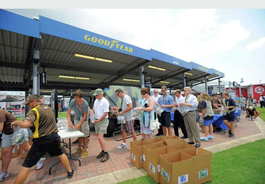 """Goodyear, NASCAR and a group of volunteers on Thursday teamed up at Daytona International Speedway to fill care packages for the troops with personalized """"thank you"""" cards and other essential items. / GOODYEAR"""