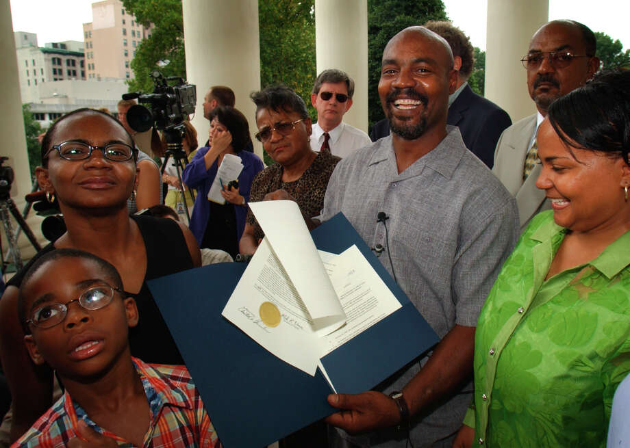 Marvin Anderson smiles as he holds the unconditional pardon issued, by Virginia Gov. Warner as his sister Garnetta Bishop, left, and other family members surround him in front of the Capitol in Richmond, Va., on Aug. 21, 2002. Anderson spent 15 years in prison after he was misidentified by a rape victim in a lineup. Photo: STEVE HELBER / AP2002