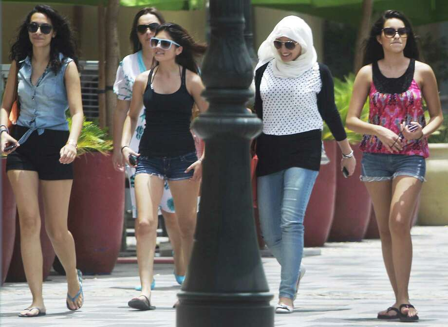 Women of different nationalities walk at the Jumeirah Beach Residence Walk in Dubai , United Arab Emirates in this file photo.. Photo: Kamran Jebreili / AP