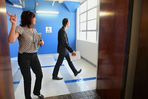 Austin Allison (right), 26, founder and CEO of an online real estate site called DotLoop, searching for office property with his broker Donnette Clarens (left) in San Francisco, California, on Tuesday, June 12, 2012.  Austin is moving his company from Cincinnati.