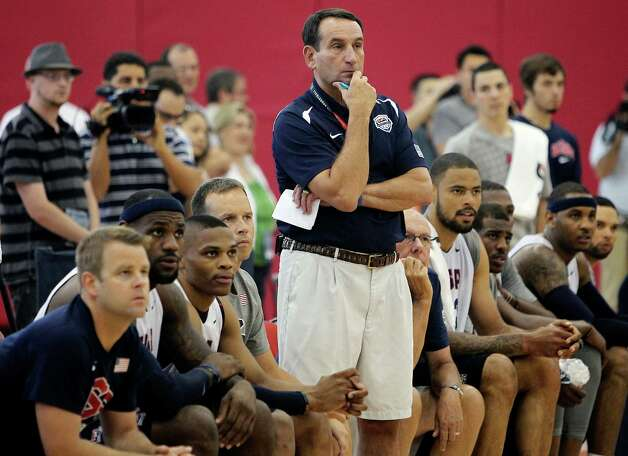 U.S. men's basketball coach Mike Krzyzewski (center) watches intently during practice Friday. Team USA's roster will be trimmed from 15 players to 12 today. Photo: Jason Bean, Associated Press
