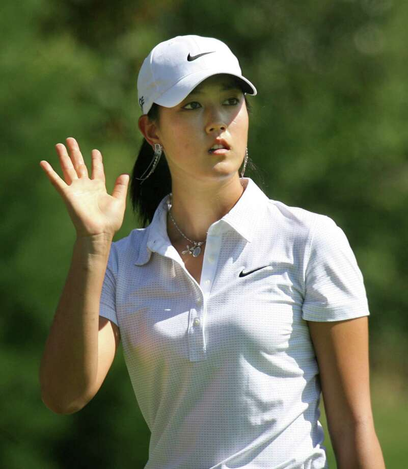 Michelle Wie, waves to the crowd on the first hole Saturday, Aug. 25, 2007, during the second round of Safeway Classic golf tournament, in Portland, Ore.  (AP Photo/Rick Bowmer) Photo: Rick Bowmer / AP