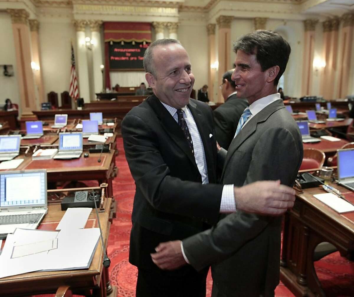 Senate President Pro Tem Darrell Steinberg, D-Sacramento, left, and Sen. Mark Leno, D-San Francisco, celebrate after Leno's bill authorizing about $4.5 billion funding for a high-speed rail system was approved by the Senate at the Capitol in Sacramento, Calif., Friday, July 6, 2012. The bill, which would allow the state to begin selling $2.6 billion in voter -approved bonds, passed by a 21-16 vote and now goes to Gov. Jerry Brown who has supports the measure.(AP Photo/Rich Pedroncelli)