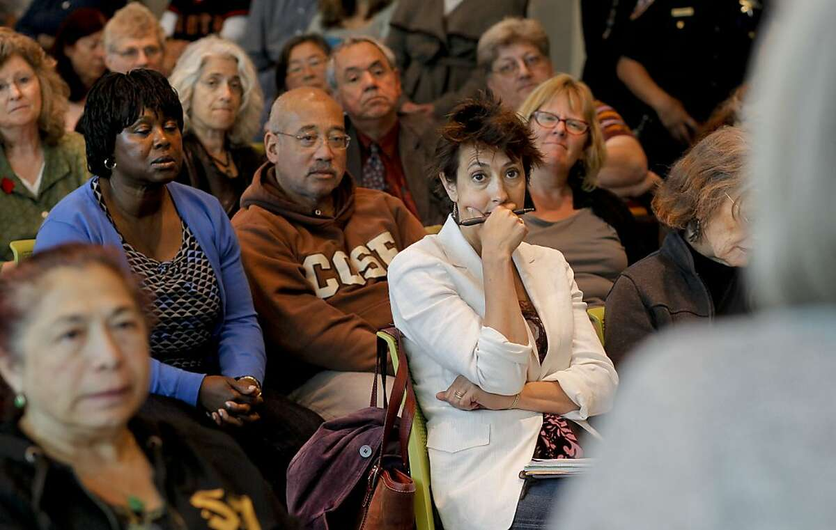 The crowd of faculty and staff listens, as Interim Chancellor, Dr. Pamila Fisher discusses the accreditation situation the City College of San Francisco is currently facing, on Friday July 6, 2012, on campus in San Francisco, Calif.