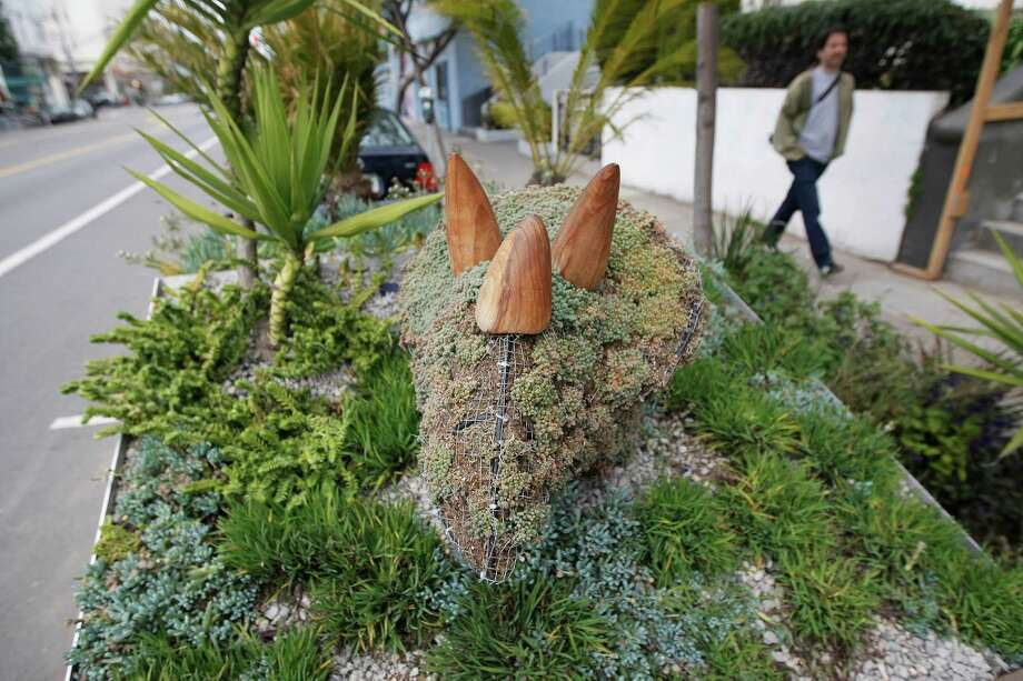 At Deepistan National Parklet, on Valencia Street in the Mission District of San Francisco, a triceratops dinosaur rears its head. Photo: Dylan Entelis / ONLINE_YES