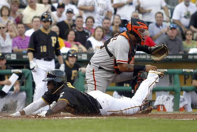 PITTSBURGH, PA - JULY 6:  Josh Harrison #5 of the Pittsburgh Pirates slides in safe on an RBI single by Andrew McCutchen #22 (not pictured) against Hector Sanchez #29 of the San Francisco Giants during the game on July 6, 2012 at PNC Park in Pittsburgh, Pennsylvania.  (Photo by Justin K. Aller/Getty Images) Photo: Justin K. Aller, Getty Images
