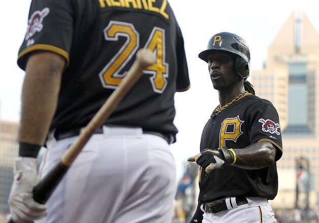 PITTSBURGH, PA - JULY 6:  Andrew McCutchen #22 of the Pittsburgh Pirates celebrates after scoring on a Neil Walker #18 (not pictured) double in the third inning against the San Francisco Giants on July 6, 2012 at PNC Park in Pittsburgh, Pennsylvania.  (Photo by Justin K. Aller/Getty Images) Photo: Justin K. Aller, Getty Images