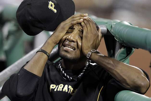 With game-time temperatures in the 90s Pittsburgh Pirates' James McDonald wipes his face in the dugout during the eighth inning of a baseball game against the San Francisco Giants in Pittsburgh, Friday, July 6, 2012. The Giants won 6-5. (AP Photo/Gene J. Puskar) Photo: Gene J. Puskar, Associated Press