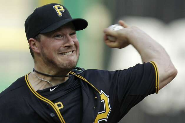 Pittsburgh Pirates pitcher Erik Bedard delivers during the first inning of a baseball game against the San Francisco Giants in Pittsburgh Friday, July 6, 2012.(AP Photo/Gene J. Puskar) Photo: Gene J. Puskar, Associated Press