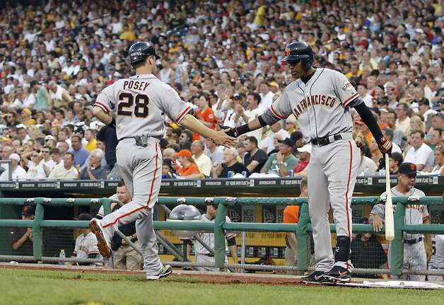 PITTSBURGH, PA - JULY 6:  Buster Posey #28 of the San Francisco Giants celebrates after scoring on a RBI single by Hector Sanchez #29 (not pictured) against the Pittsburgh Pirates during the game on July 6, 2012 at PNC Park in Pittsburgh, Pennsylvania.  (Photo by Justin K. Aller/Getty Images) Photo: Justin K. Aller, Getty Images