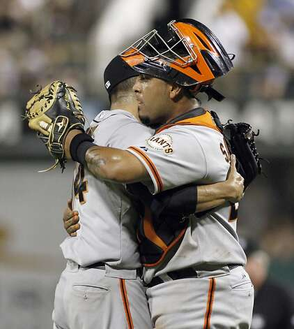 PITTSBURGH, PA - JULY 6:  Hector Sanchez #29 and Sergio Romo #54 of the San Francisco Giants celebrate after defeating the Pittsburgh Pirates on July 6, 2012 at PNC Park in Pittsburgh, Pennsylvania.  The Giants defeated the Pirates 6-5.  (Photo by Justin K. Aller/Getty Images) Photo: Justin K. Aller, Getty Images