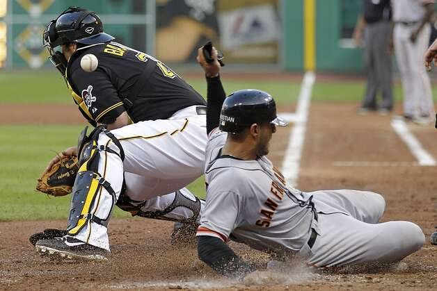 San Francisco Giants' Justin Christian, right, scores on a double to center field by Giants' Ryan Theriot as the throw gets away from Pittsburgh Pirates catcher Rod Barajas during the fourth inning of a baseball game in Pittsburgh, Friday, July 6, 2012. (AP Photo/Gene J. Puskar) Photo: Gene J. Puskar, Associated Press