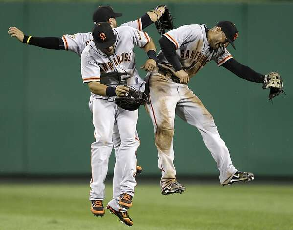 San Francisco Giants outfielders Milky Cabrera, front left, Gregor Blanco, rear left, and Justin Christian, right, celebrate after the final out of the ninth inning during a baseball game against the Pittsburgh Pirates in Pittsburgh, Friday, July 6, 2012. The Giants won 6-5. (AP Photo/Gene J. Puskar) Photo: Gene J. Puskar, Associated Press