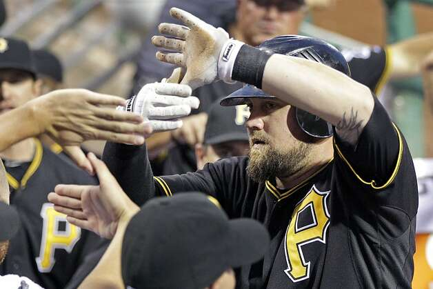 Pittsburgh Pirates' Casey McGhee, right, celebrates with teammates after hitting a solo home run off San Francisco Giants pitcher Barry Zito during the fifth inning of a baseball game against the San Francisco Giants during a baseball game in Pittsburgh, Friday, July 6, 2012. (AP Photo/Gene J. Puskar) Photo: Gene J. Puskar, Associated Press