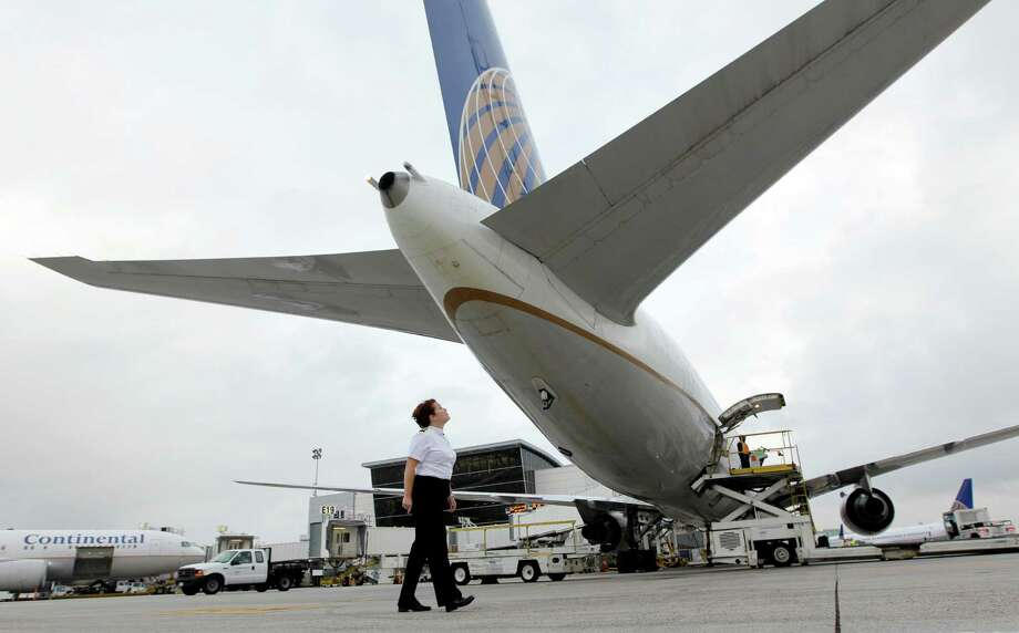 A Boeing 767 undergoes a preflight inspection at Bush Intercontinental Airport. United says its IAH-Paris flight is unprofitable. Photo: David J. Phillip / AP2010