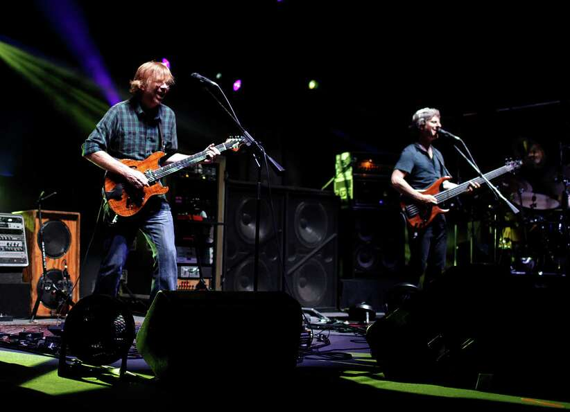 Trey Anastasio, left, lead vocalist and guitarist for the band Phish, and Mike Gordon on bass, right